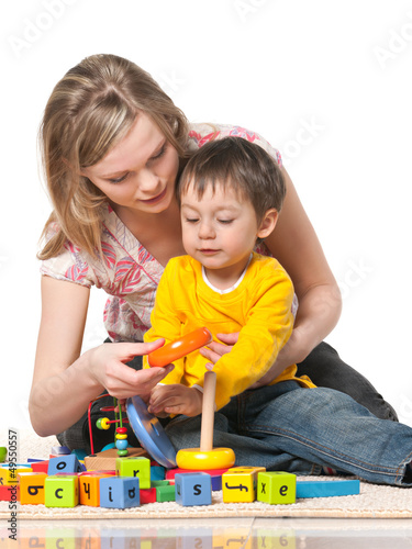 Mother and son on the floor with toys