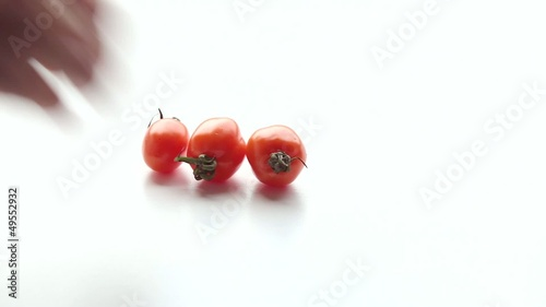 Woman puts tomatoes on  the table. Part 3.