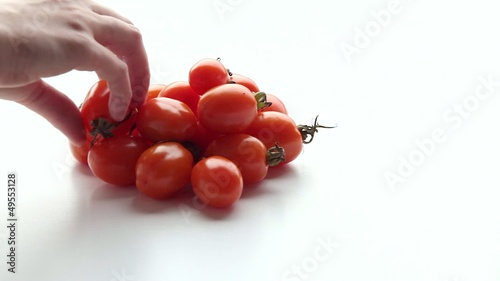 Woman takes tomatoes. Part 1.
