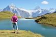Traveler against Swiss Alps