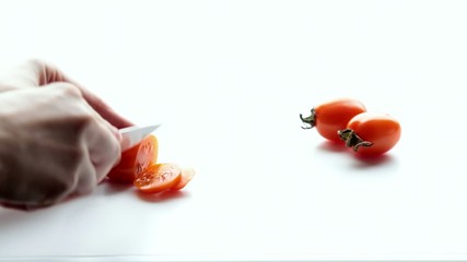 Woman cuts a tomato. Part 2