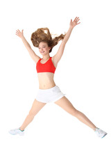 young fitness woman jumping isolated over white