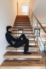 interior, man sitting on the stairs