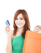 young woman holding credit card with shopping bag