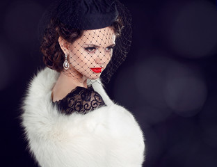 Beautiful woman in fur coat. Jewelry and Beauty. Fashion photo