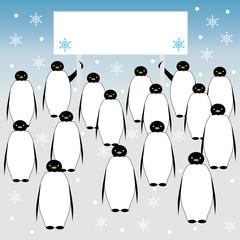 Penguins holding a banner