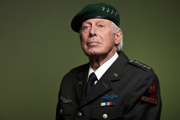US military general wearing beret. Studio portrait.