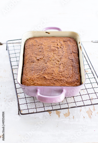 Date cake in enamel pan