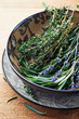 Fresh rosemary, thyme and dried lavender in a bowl