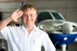 Portrait of young pilot with down syndrome in hangar. - 49557742