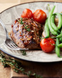 Rustic steak with vegetables and herbs