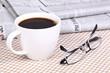 Fresh hot coffee on newspaper
