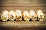 Dated wine bottle corks on the wooden background