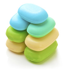 Stack of new colorful Soap Bars on white background.