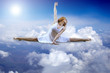 Ballerina seating on the sky clouds