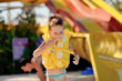 little boy in a yellow life jacket is going to dive into the wat