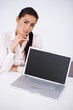 Business woman sitting at her desk with laptop