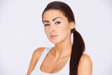 Brunette woman with ponytail haircut poster