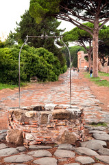 Well on old roman stony street at Ostia Antica - Rome