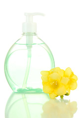 Bottle with liquid soap and flower isolated on white