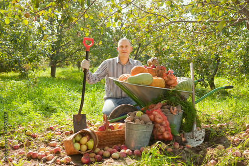 Happy man with vegetables harvest