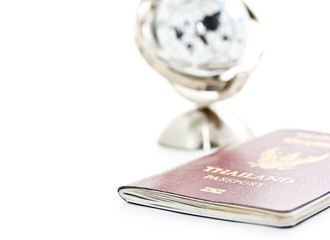 passport and global model on white background