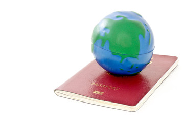 passport and global model toy on white background