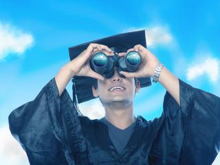 Graduate looking through Binocular