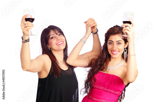 Two happy cheering women raising wine glass