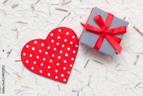 small gift with woden red heart