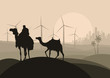 Wind electricity generators, windmills and camel caravan in arab