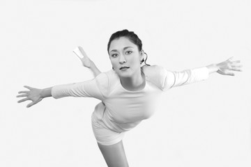 Young woman in flying pose