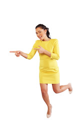 Happy pointing woman in full length