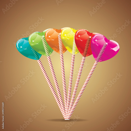 Set of varicolored heart lollipops
