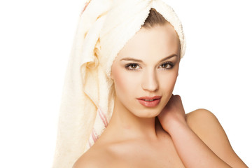 beautiful young woman with a towel on her head after bath