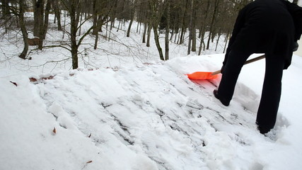 man shovel tool clean snow roof winter