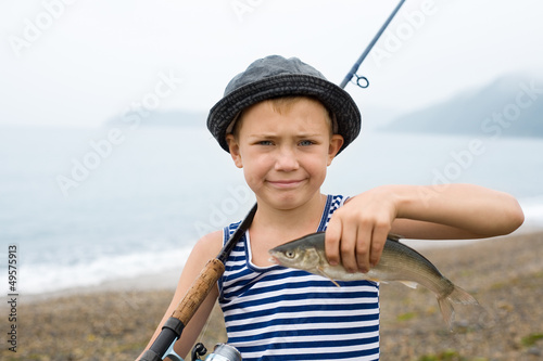 Boy holding a fish