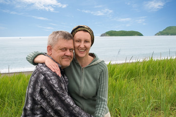 Happy middle aged couple by the sea.