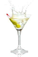 Olive splashing on martini glass isolated on white