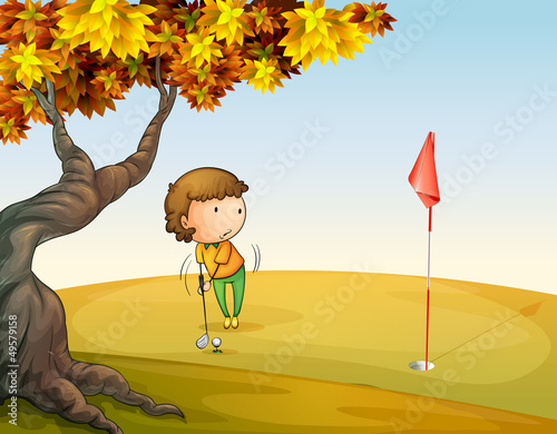A woman playing golf at the park
