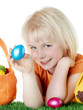 Cute blonde child shows her Easter eggs