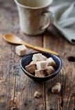 Brown sugar cubes in small ceramic dish