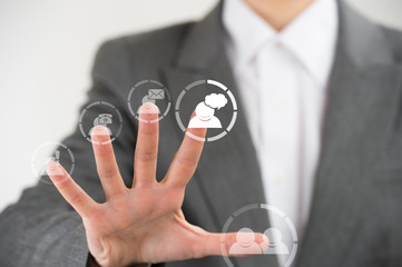 Business woman pointing her fingers on virtual web interface ico