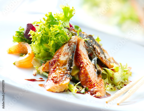 Fotobehang Salade Salad With Smoked Eel with Unagi Sauce. Japanese Food