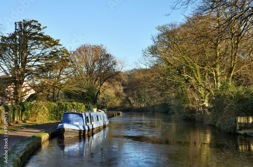 Blue barge moored on the Lancaster Canal