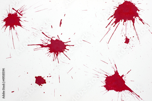 Red blood splash on white paper