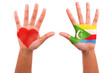 African hands with a painted heart and comorian flag, i love  co