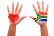 African hands with a painted heart and south african flag, i lov
