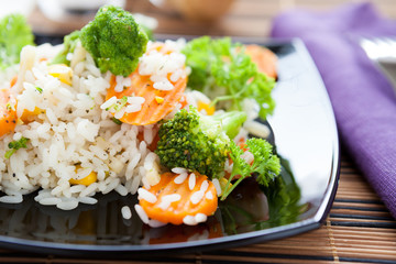 rice with roasted carrots and broccoli