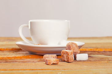 Image of coffee cup in front of sugar pieces